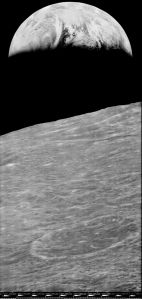The view of Earth cresting over the moon's horizon