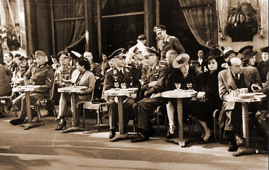 German Officers and french civilians enjoying a cafe in Paris - how uncivilised of them